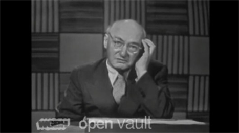 "still of I.A. Richards wearing glasses with his head resting in one hand; the words ""WGBH open vault"" appear at the bottom of the screen"