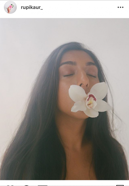 photo of Rupi Kaur with flower