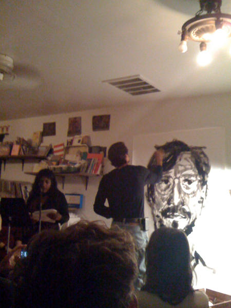 Bhargavi Mandava reading accompanying/accompanied by Mark Sylbert drawing in the front room.