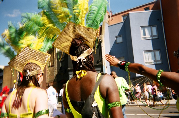 Back view of carnival performers