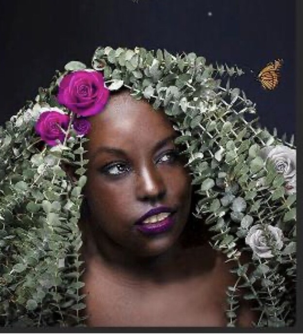 Vanessa Rochelle Lewis with flowers and eucalyptus strands in her hair