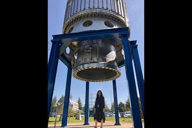 Amy Catanzano at CERN under the Big European Bubble Chamber in the garden of de