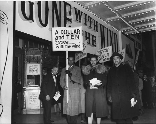 Protesters picket the movie Gone with the Wind