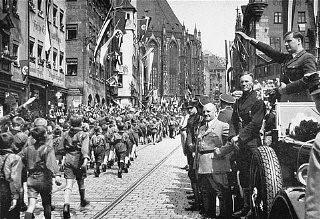 Baldur von Schirach, Gauleiter of Vienna, at right, saluting